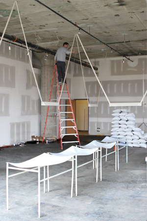 Jonathan Muecke installing his piece for New Physical Consequences. Photo courtesy of Simone DeSousa